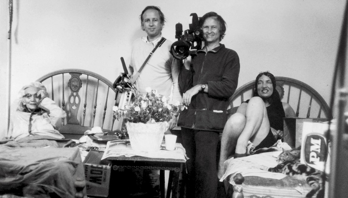 "Albert and David Maysles pose between ""Big Edie"" and ""Little Edie"" Bouvier Beale, the subjects of their 1976 documentary <i>Grey Gardens</i>."
