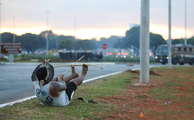 Amerindians clash with the police in Brasilia while protesting for land rights and against the 2014 World Cup hosted by Brazil.