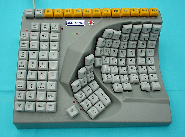 "The manufacturer's copy for the product reads: ""Maltron single hand keyboards have been developed as a logical step forward to meet the needs of those who must perform keyboard operations with one hand. The shape matches natural hand movement and the key arrangement minimizes finger movement, raising speed, and relieving frustration."""