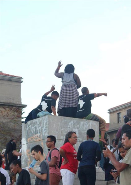 Women dance atop the empty pedestal after Cecil John Rhodes's statue was removed from University of Cape Town campus, 2015.