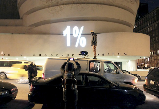An illumination action targets the facade of the Guggenheim Museum on March 24, 2014.