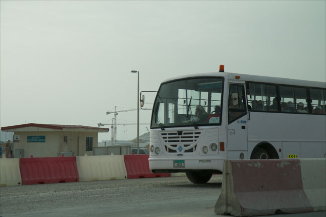 Workers are transported from the construction site on Saadiyat Island to their accommodation camps on March 17, 2015.