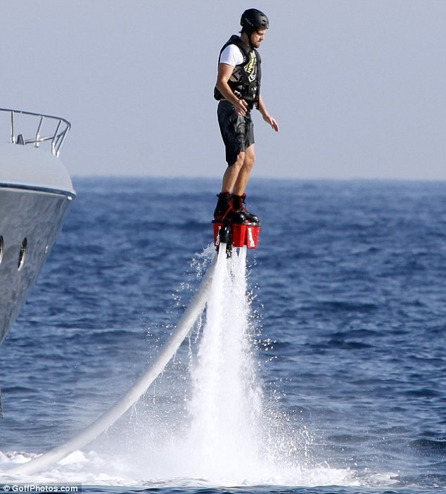 Leonardo DiCaprio blasts above the ocean on a jet pack in Ibiza, Spain on August 7, 2013. Photo: Goffphotos.com.