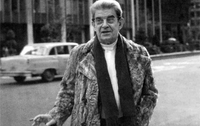 The philosopher and psychoanalyst Jacques Lacan sports a fur coat for extra surface effect.