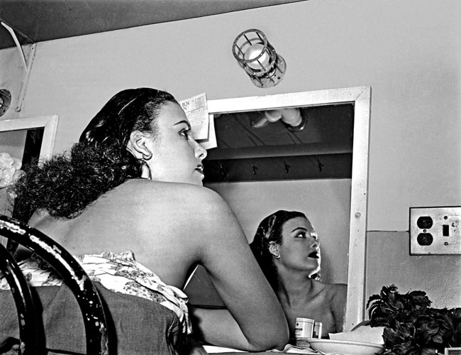 Lena Horne reflected in the dressing room mirror at Stanley Theatre, Pittsburgh, Pennsylvania, c. 1944. Photo: Teenie Harris Archive/Carnegie Museum of Art