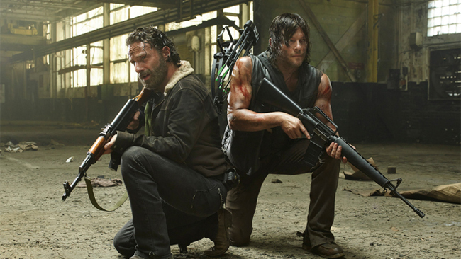 Characters pose armed in this publicity still for the sixth season of the AMC television series <em>The Walking Dead</em>.