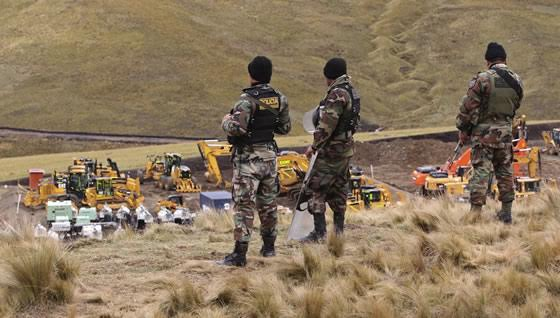 Police guard the machinery of Yanacocha, the largest gold mine in South America.